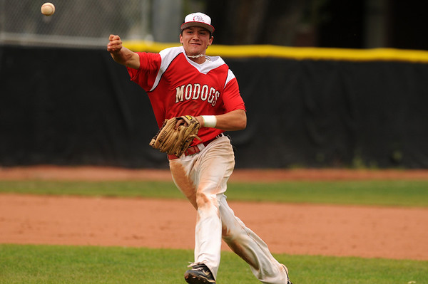 Brighton Modogs short stop Brandon Vaughn tries to make a play at first base during their game at Scott Carpenter Park Thursday, July 8, 2010 during the 4th annual Boulder National Invitational Tournament. The Modogs defeated Mountain View 6-2. Photo by Jeremy Papasso The Camera