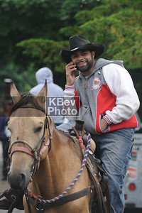 Modern cowboys use cell phones