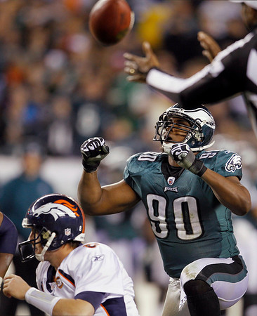 Philadelphia Eagles' Darren Howard (90) reacts after sacking Denver Broncos' Kyle Orton, left, in the second half of an NFL football game, Sunday, Dec. 27, 2009, in Philadelphia. (AP Photo/Matt Slocum)