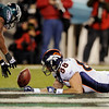 Denver Broncos' Tony Scheffler, right, and Philadelphia Eagles' Sheldon Brown reach for an incomplete pass in the first half of an NFL football game, Sunday, Dec. 27, 2009, in Philadelphia. (AP Photo/Michael Perez)