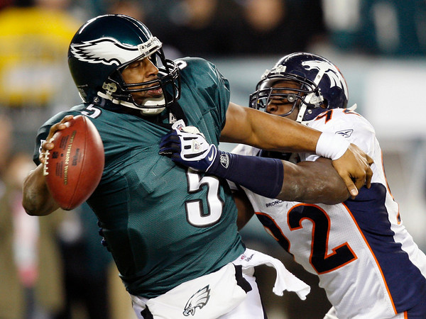 Philadelphia Eagles' Donovan McNabb, left, is sacked by Denver Broncos' Elvis Dumervil in the second half of an NFL football game, Sunday, Dec. 27, 2009, in Philadelphia. Philadelphia won 30-27. (AP Photo/Mel Evans)