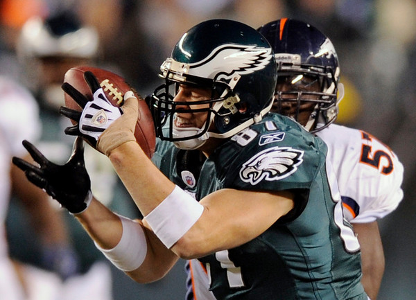 Philadelphia Eagles' Brent Celek, left, pulls in a pass as Denver Broncos' Mario Haggan defends in the first half of an NFL football game, Sunday, Dec. 27, 2009, in Philadelphia. (AP Photo/Michael Perez)