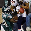 Denver Broncos' Jabar Gaffney, right, hangs onto a touchdown pass as Philadelphia Eagles' Will Witherspoon defends in the first half of an NFL football game, Sunday, Dec. 27, 2009, in Philadelphia. (AP Photo/Mel Evans)