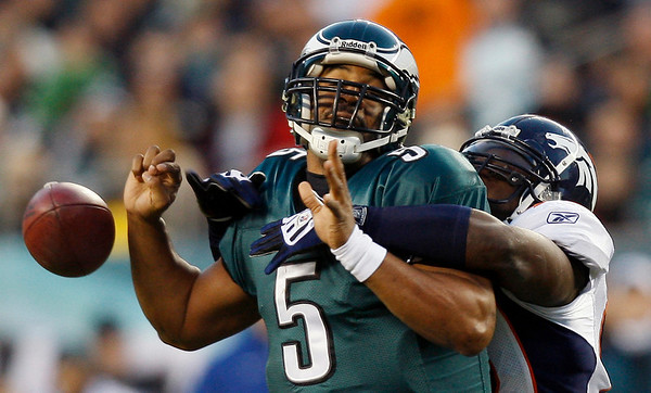 Philadelphia Eagles' Donovan McNabb, left, fumbles the ball as he is sacked by Denver Broncos' Elvis Dumervil in the first half of an NFL football game, Sunday, Dec. 27, 2009, in Philadelphia. (AP Photo/Mel Evans)