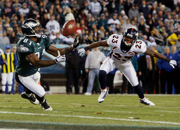 Philadelphia Eagles' Jason Avant (81) catches a tipped pass for a touchdown as Denver Broncos' Renaldo Hill (23) defends in the second half of an NFL football game, Sunday, Dec. 27, 2009, in Philadelphia. (AP Photo/Matt Slocum)