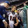 Denver Broncos' Brandon Stokley (14) is escorted off the field after being ejected in the first half of an NFL football game against the Philadelphia Eagles, Sunday, Dec. 27, 2009, in Philadelphia. (AP Photo/Matt Slocum)