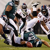 Philadelphia Eagles' Donovan McNabb, center, fumbles the football as he is sacked by Denver Broncos' Elvis Dumervil in the first half of an NFL football game, Sunday, Dec. 27, 2009, in Philadelphia. (AP Photo/Matt Slocum)