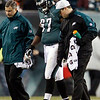 In this Dec. 27, 2009 photo, Philadelphia Eagles' Jamaal Jackson, center, is escorted off the field by Eagles staff after Jackson tore a knee ligament in the first half of an NFL football game against the Denver Broncos, in Philadelphia. (AP Photo/Matt Slocum)