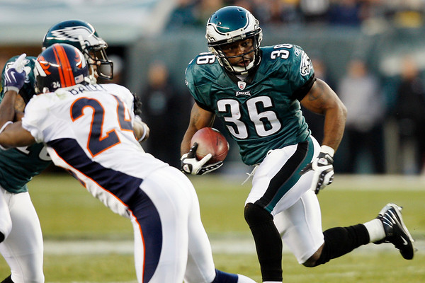 Philadelphia Eagles' Brian Westbrook, right, rushes in the first half of an NFL football game against the Denver Broncos, Sunday, Dec. 27, 2009, in Philadelphia. (AP Photo/Mel Evans)