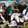 Philadelphia Eagles' Donovan McNabb (5) tries to break away from Denver Broncos' Elvis Dumervil (92) and D.J. Williams (55) in the first half of an NFL football game, Sunday, Dec. 27, 2009, in Philadelphia. (AP Photo/Mel Evans)
