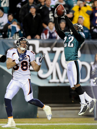 Philadelphia Eagles' Asante Samuel, right, intercepts a pass intended for Denver Broncos' Tony Scheffler in the second half of an NFL football game, Sunday, Dec. 27, 2009, in Philadelphia. (AP Photo/Michael Perez)