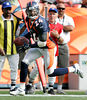 Champ Bailey interception for touchdown in 3rd qtr in Denver on Sunday, Sept. 18, 2005.  Photo by K.C. Alfred U-T