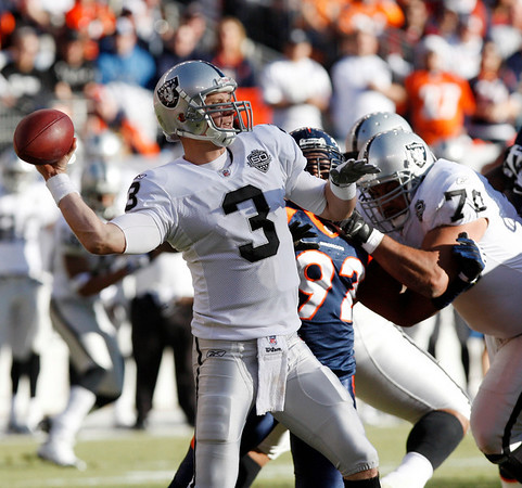 Oakland Raiders quarterback Charlie Frye sets up to pass against the Denver Broncos during the first quarter of an NFL  football game in Denver on Sunday, Dec. 20, 2009. (AP Photo/Ed Andrieski)