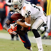Oakland Raiders wide receiver Louis Murphy drops a pass during the second quarter of an NFL football game against the Denver Broncos at Invesco Field at Mile High in Denver, Sunday, Dec. 20, 2009. (AP Photo/Jack Dempsey)