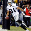 Oakland Raiders' Chaz Schilens celebrates his 10-yard touchdown reception during the fourth quarter of an NFL football game against the Denver Broncos at Invesco Field at Mile High in Denver, Sunday, Dec. 20, 2009. Oakland beat Denver 20-19. (AP Photo/Jack Dempsey)