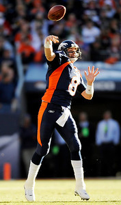 Denver Broncos quarterback Kyle Orton throws in the first quarter of an NFL football game against the Oakland Raiders in Denver on Sunday, Dec. 20, 2009.  (AP Photo/Chris Schneider)