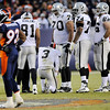 Oakland Raiders quarterback Charlie Frye (3) kneels after being shaken up from a hit by the Denver Broncos defense in the fourth quarter of an NFL football game in Denver on Sunday, Dec. 20, 2009.  Frye left the game and was replaced by JaMarcus Russell. The Raiders won 20-19. (AP Photo/Chris Schneider)