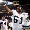 Oakland Raiders' Gerard Warren celebrates a team victory following  an NFL football game against the Denver Broncos at Invesco Field at Mile High in Denver, Sunday, Dec. 20, 2009. Oakland defeated Denver 20-19. (AP Photo/Jack Dempsey)