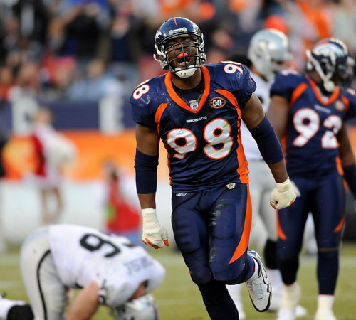 Denver Broncos' Ryan McBean (98) celebrates after Denver recovered an Oakland Raiders fumble in the third quarter of an NFL  football game in Denver on Sunday, Dec. 20, 2009. (AP Photo/Chris Schneider)