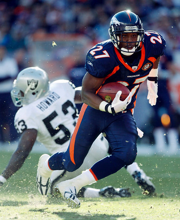 Denver Broncos running back Knowshon Moreno (27) breaks into the secondary around Oakland Raiders linebacker Thomas Howard (53) during the first quarter of an NFL  football game in Denver on Sunday, Dec. 20, 2009. (AP Photo/Jack Dempsey)