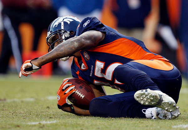 Denver Broncos wide receiver Brandon Marshall reacts after catching a pass for a touchdown against the Oakland Raiders in the third quarter of an NFL football game in Denver on Sunday, Dec. 20, 2009. (AP Photo/David Zalubowski)