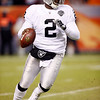 Oakland Raiders quarterback JaMarcus Russell scrambles during the fourth quarter of an NFL football game against the Denver Broncos at Invesco Field at Mile High in Denver, Sunday, Dec. 20, 2009. Oakland defeated Denver 20-19. (AP Photo/Jack Dempsey)