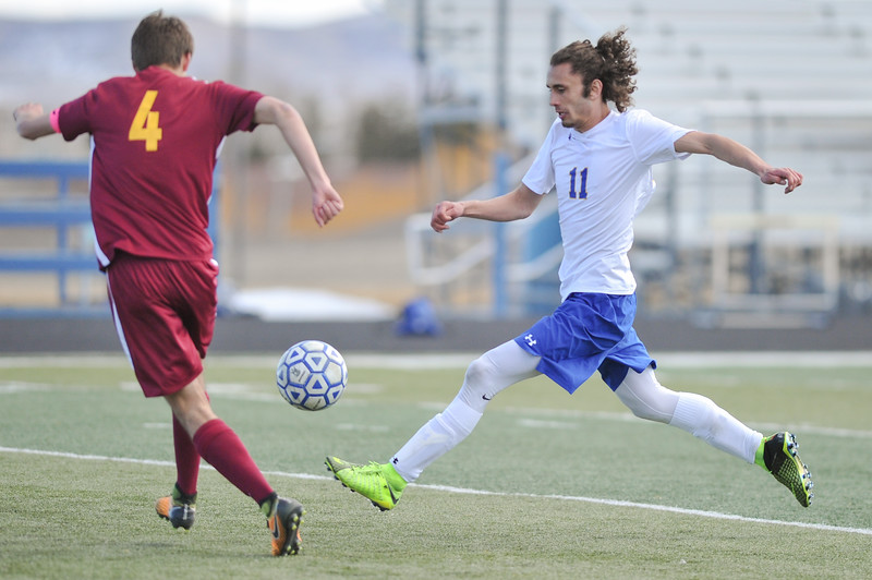 Tibby McDowell | The Sheridan Press<br /> Bryce Taylor (11) makes a shot on goal against Laramie during the last two minutes of regular play at Homer Scott Field Saturday, March 24, 2018.  The Broncs had a scoreless draw with the Plainsmen in a two overtime match.