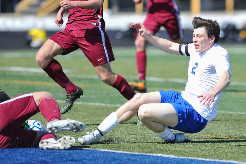 Tibby McDowell | The Sheridan Press<br /> Aaron Sessions follows his shot on goal and slides into the Laramie goalie at Homer Scott Field Saturday, March 24, 2018.