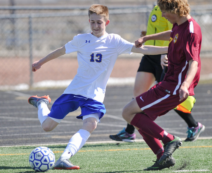 Tibby McDowell | The Sheridan Press<br /> Carter Wells kicks the ball into the center of the field against Laramie at Homer Scott Field Saturday, March 24, 2018.