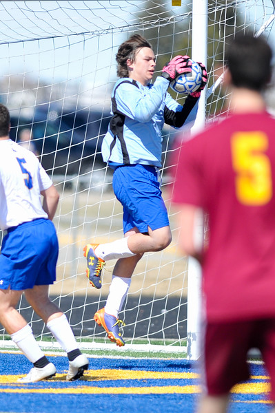Tibby McDowell | The Sheridan Press<br /> Keeper Samuel Salyards blocks an attempt on goal by Laramie at Homer Scott Field Saturday, March 24, 2018. The Broncs had a scoreless draw with the Plainsmen in a two overtime match.