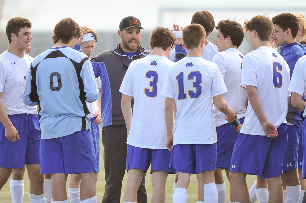 Tibby McDowell | The Sheridan Press<br /> Head coach Scott Soderstrom talks strategy with the team during a two minute time out between first and second overtime periods at Homer Scott Field Saturday, March 24, 2018.