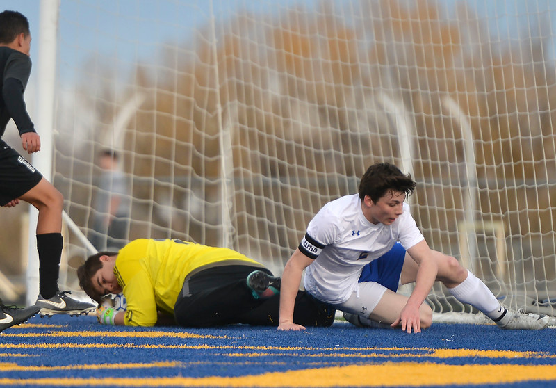 Justin Sheely   The Sheridan Press<br /> Sheridan's Aaron Sessions attempts a goal against Cheyenne South's Isaiah Reynolds at Homer Scott Field Friday, March 23, 2018. The Broncs fell 3-1.
