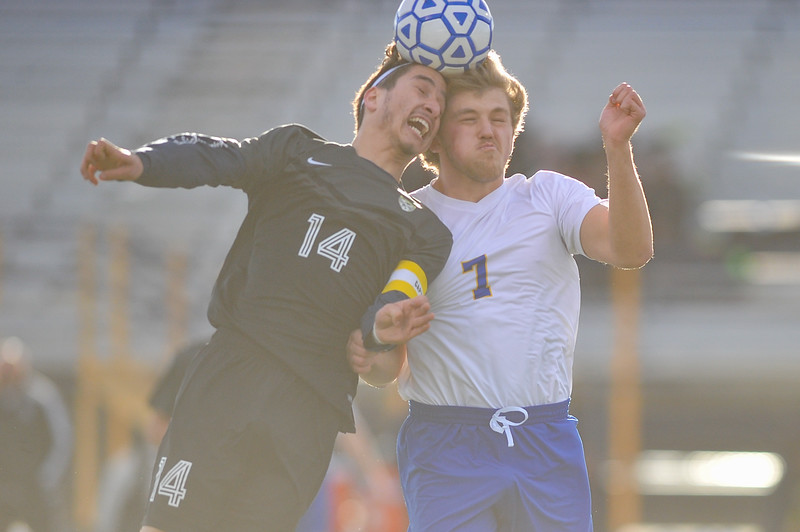 Tibby McDowell   The Sheridan Press<br /> Sheridan's Jack Chase, right, goes for the header against Cheyenne South's Brian Gonzalez at Homer Scott Field Friday, March 23, 2018.