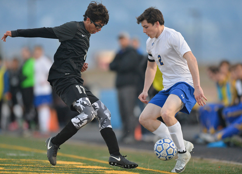 Justin Sheely   The Sheridan Press<br /> Sheridan's Aaron Sessions, right, controls the ball against Cheyenne South's Rodrigo Velazquez at Homer Scott Field Friday, March 23, 2018. The Broncs fell 3-1.