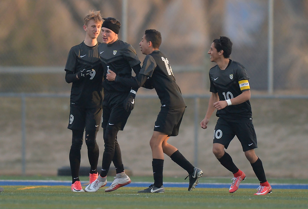 Justin Sheely | The Sheridan Press<br /> Cheyenne South players, from left, Tyler Flynn, AJ Johnson Pablo Sanchez and Jose Guerrero celebrate their second goal against Sheridan at Homer Scott Field in Sheridan Friday, March 23, 2018.