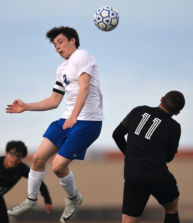 Justin Sheely | The Sheridan Press<br /> Sheridan's Aaron Sessions, left, goes for a header against Cheyenne South's Zeuss Jimenez at Homer Scott Field Friday, March 23, 2018. The Broncs fell 3-1.