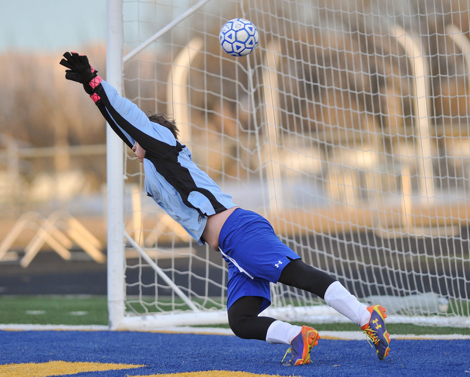 Tibby McDowell | The Sheridan Press<br /> Sheridan goalie Sam Salyards fails to block the shot from Cheyenne Central at Homer Scott Field Friday, March 23, 2018.