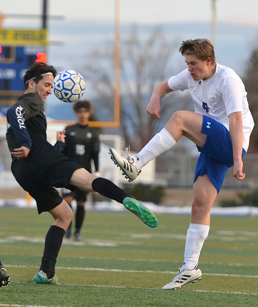 Justin Sheely   The Sheridan Press<br /> Sheridan's Tristan Bower, right, battles for the ball against Cheyenne South's Brian Gonzalez at Homer Scott Field Friday, March 23, 2018. The Broncs fell 3-1.