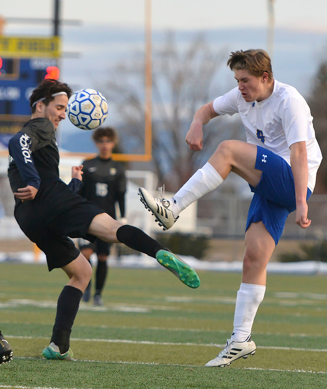 Justin Sheely | The Sheridan Press<br /> Sheridan's Tristan Bower, right, battles for the ball against Cheyenne South's Brian Gonzalez at Homer Scott Field Friday, March 23, 2018. The Broncs fell 3-1.