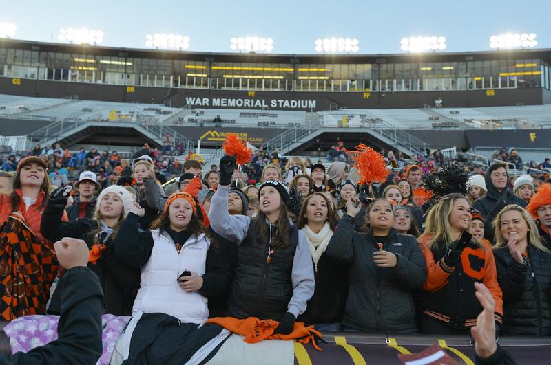 Justin Sheely | The Sheridan Press<br /> Mustang fans cheer during the class 4A state championship match Saturday, November 11, 2017, at War Memorial Stadium in Laramie. The Broncs claimed their third-straight state title after beating the Mustangs 28-14. The Sheridan Broncs were undefeated for their season.