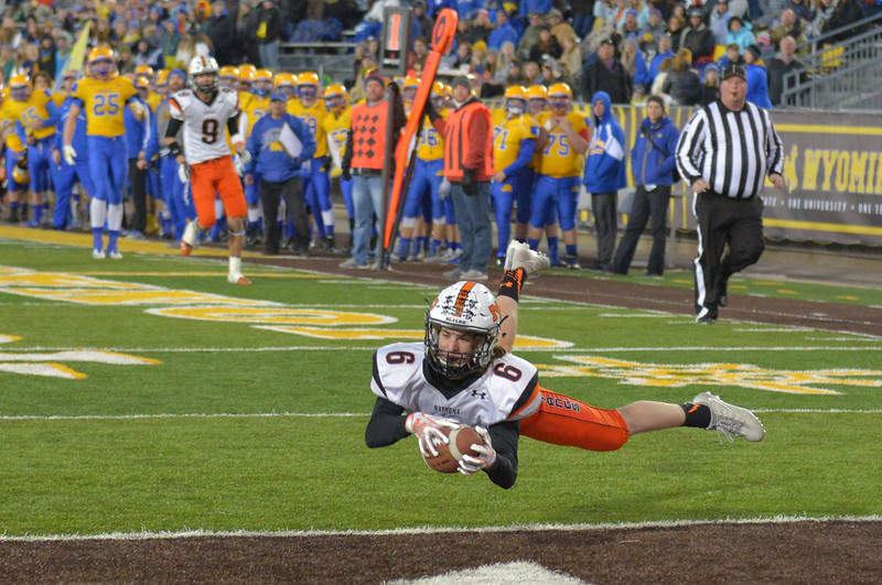 Justin Sheely | The Sheridan Press<br /> Natrona's Ben Acres catches an interception during the class 4A state championship match Saturday, November 11, 2017, at War Memorial Stadium in Laramie. The Broncs claimed their third-straight state title after beating the Mustangs 28-14. The Sheridan Broncs were undefeated for their season.