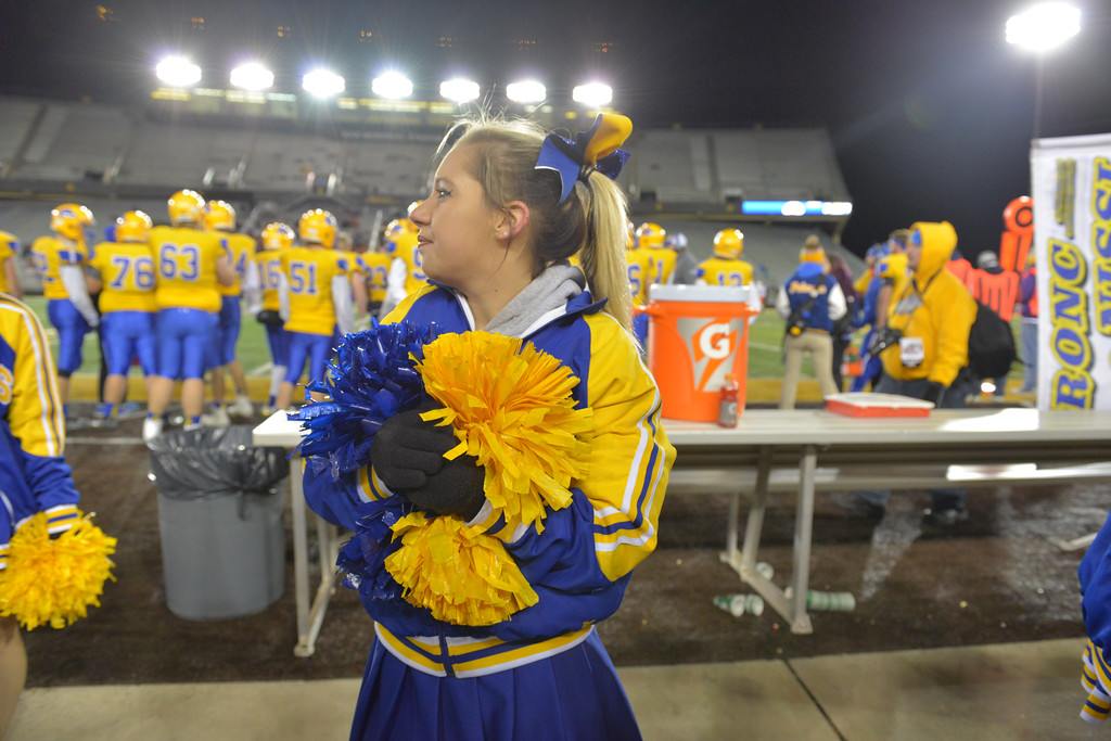Justin Sheely | The Sheridan Press<br /> A Sheridan Cheerleader stands at the sidelines in the second half of the class 4A state championship match against Natrona County High School Saturday, November 11, 2017, at War Memorial Stadium in Laramie. The Broncs claimed their third-straight state title after beating the Mustangs 28-14. The Sheridan Broncs were undefeated for their season.