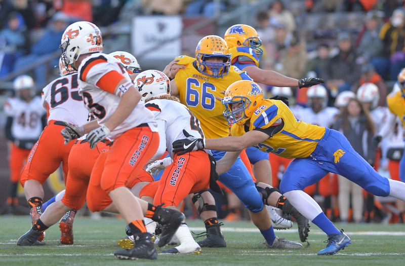 Justin Sheely | The Sheridan Press<br /> Sheridan's Max Myers (66) and Quinton Brooks (62) tackle Mustangs' Brett Breton during the class 4A state championship match against Natrona County High School Saturday, November 11, 2017, at War Memorial Stadium in Laramie. The Broncs claimed their third-straight state title after beating the Mustangs 28-14. The Sheridan Broncs were undefeated for their season.