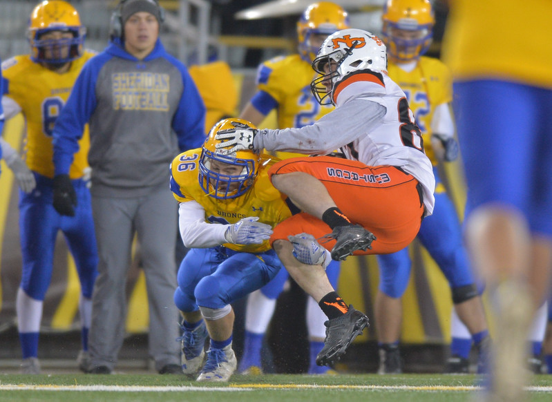 Justin Sheely | The Sheridan Press<br /> Sheridan's Jaron Brewer stops Mustangs' Cooper Quig in the second half of the class 4A state championship match against Natrona County High School Saturday, November 11, 2017, at War Memorial Stadium in Laramie. The Broncs claimed their third-straight state title after beating the Mustangs 28-14. The Sheridan Broncs were undefeated for their season.