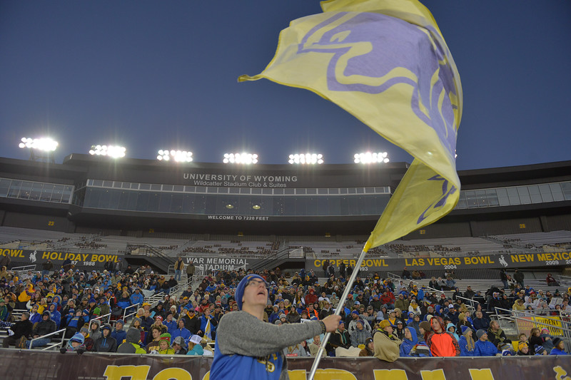 Justin Sheely | The Sheridan Press<br /> Sheridan freshman student Ian Taylor waves the Bronc flag during the class 4A state championship match against Natrona County High School Saturday, November 11, 2017, at War Memorial Stadium in Laramie. The Broncs claimed their third-straight state title after beating the Mustangs 28-14. The Sheridan Broncs were undefeated for their season.