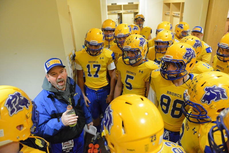Justin Sheely | The Sheridan Press<br /> Broncs head coach Don Julian rallies the troops at halftime during the class 4A state championship match against Natrona County High School Saturday, November 11, 2017, at War Memorial Stadium in Laramie. The Broncs claimed their third-straight state title after beating the Mustangs 28-14. The Sheridan Broncs were undefeated for their season.
