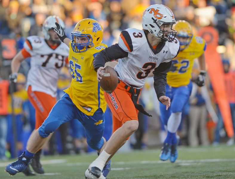 Justin Sheely | The Sheridan Press<br /> Sheridan's Will Jorgenson tries to sack Mustangs' quarterback Jesse Harshman during the class 4A state championship match against Natrona County High School Saturday, November 11, 2017, at War Memorial Stadium in Laramie. The Broncs claimed their third-straight state title after beating the Mustangs 28-14. The Sheridan Broncs were undefeated for their season.