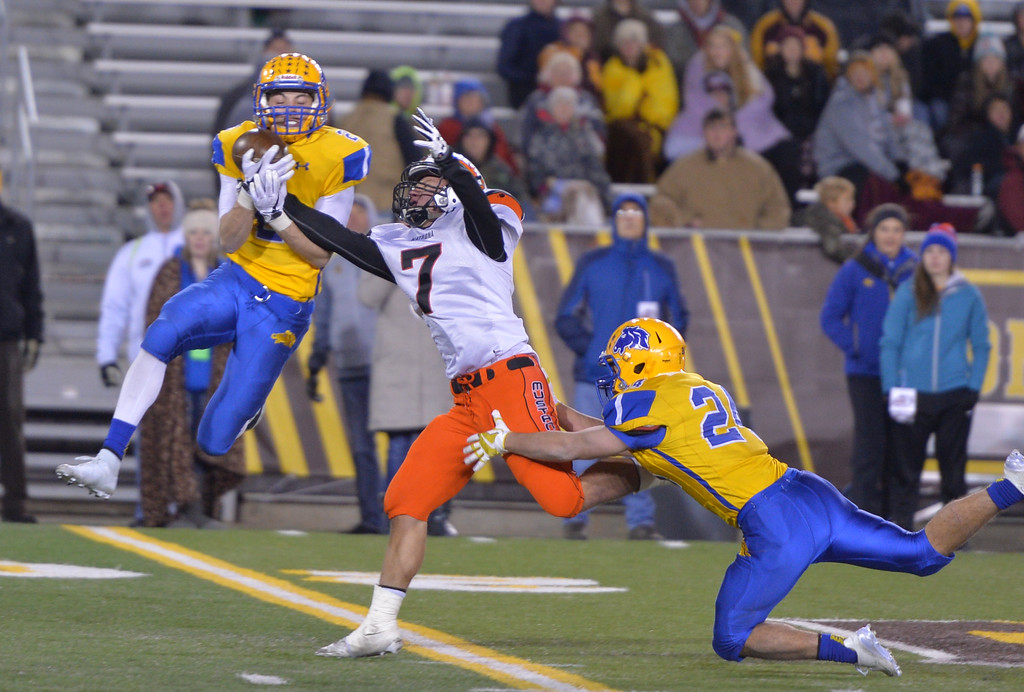 Justin Sheely | The Sheridan Press<br /> Sheridan's Aaron Sessions picks off a pass intended for Natrona's Tehl Campbell in the second half of the class 4A state championship match Saturday, November 11, 2017, at War Memorial Stadium in Laramie. The Broncs claimed their third-straight state title after beating the Mustangs 28-14. The Sheridan Broncs were undefeated for their season.