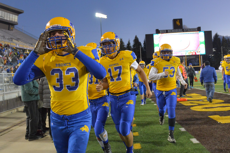 Justin Sheely | The Sheridan Press<br /> Gage Kirschner and the Broncs leave the field for halftime during the class 4A state championship match against Natrona County High School Saturday, November 11, 2017, at War Memorial Stadium in Laramie. The Broncs claimed their third-straight state title after beating the Mustangs 28-14. The Sheridan Broncs were undefeated for their season.