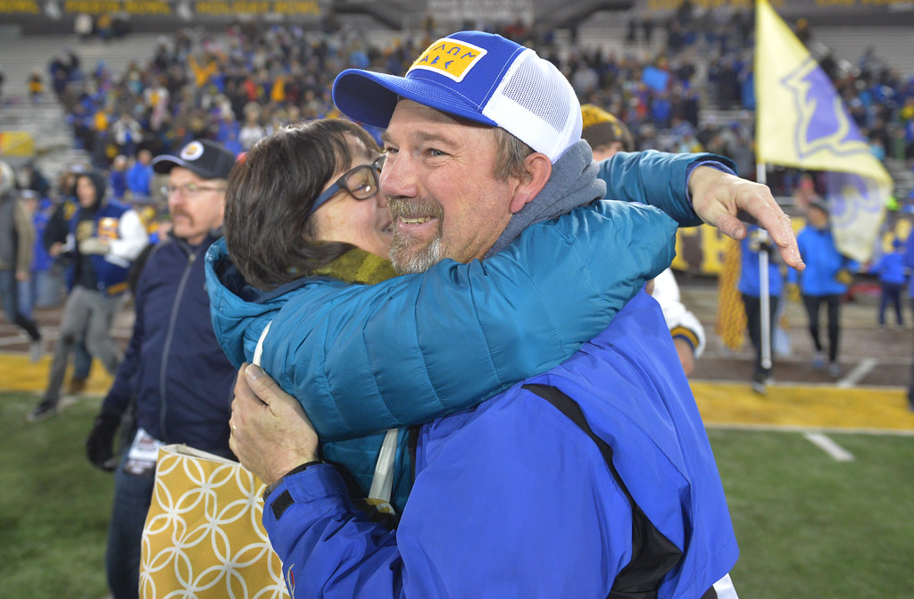 Justin Sheely | The Sheridan Press<br /> Sheridan's head coach Don Julian and family celebrate as the final second tick off the final quarter in the class 4A state championship match against Natrona County High School Saturday, November 11, 2017, at War Memorial Stadium in Laramie. The Broncs claimed their third-straight state title after beating the Mustangs 28-14. The Sheridan Broncs were undefeated for their season.
